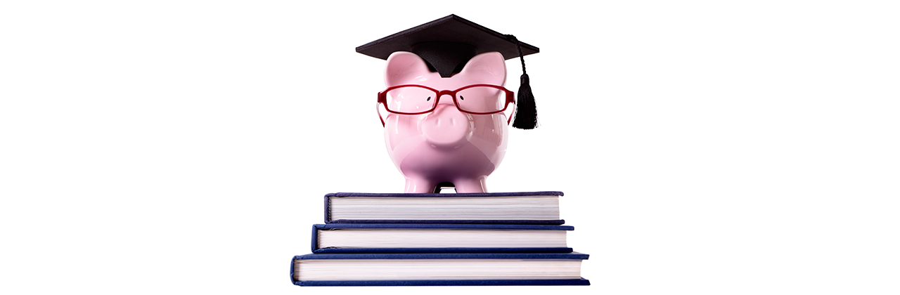 piggy bank with glasses and a grad cap on a pile of textbooks
